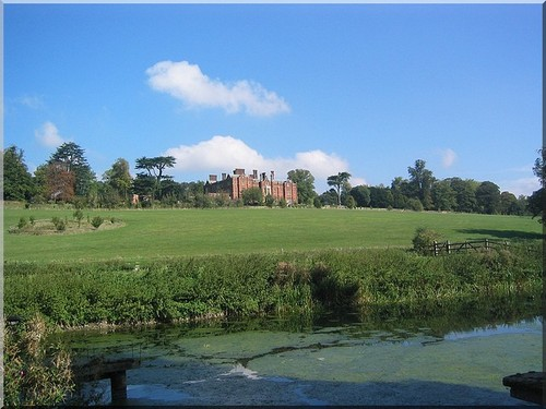 A stately home in Buckinghamshire with a river in the foreground
