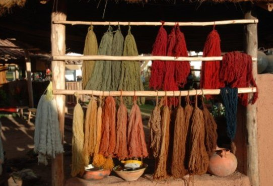 naturally dyed alpaca knitting yarn hanging up to dry
