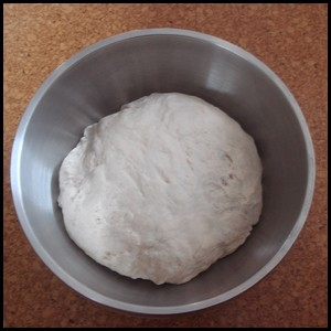Bread dough in a bowl before rising