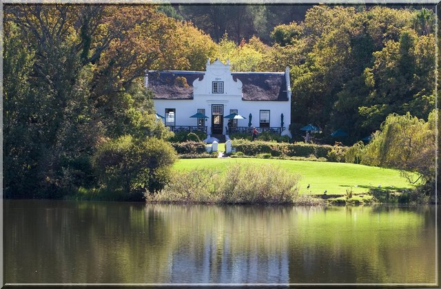 A Cape wine estate with the homestead on a lake