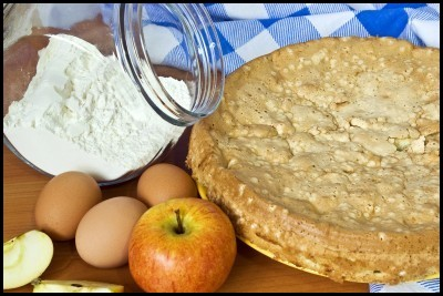 Homemade apple pie with baking ingredients