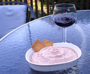 smoked salmon dip with a glass of red wine