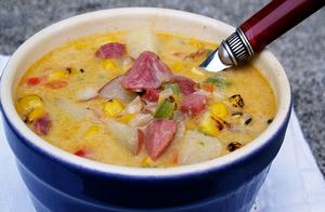 Amish corn chowder in a blue ceramic bowl