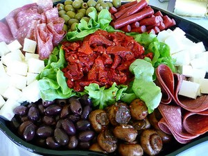 an antipasto platter of cold meats, cheese and vegetables