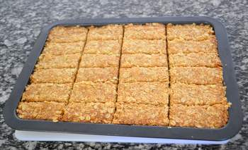 A tray of freshly baked oat bars
