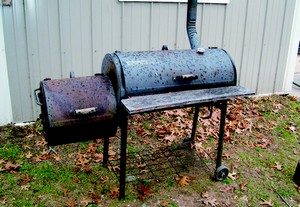 a barrel wood smoker