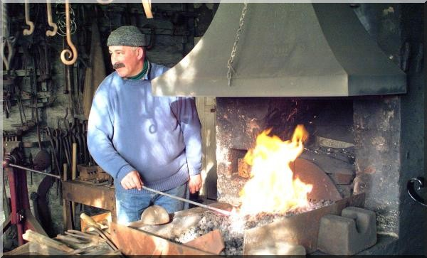 a blacksmith practising traditional skills