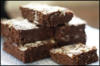 a pile of chocolate hazelnut brownies