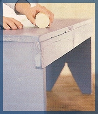 Putting wax on furniture for distressing technique