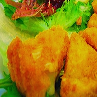 Deep fried Camembert cheese wedges on lettuce
