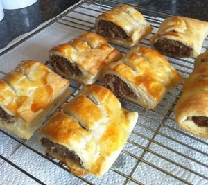 easy homemade sausage rolls cooling on a wire rack