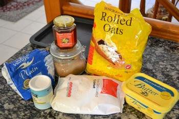 All ingredients for making oat bars.