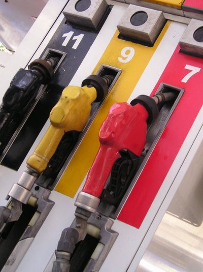 3 pumps for gasoline in black, yellow and red