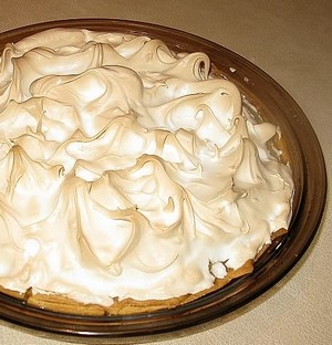 Pumpkin meringue pie cooked and waiting to be eaten.