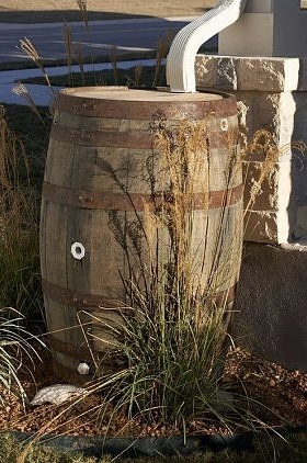 a wooden rain-barrel
