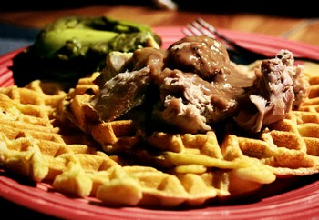 Homemade plain savory waffle with meat and gravy.