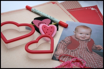 scrapbooking supplies with embellishments and a photo of a baby