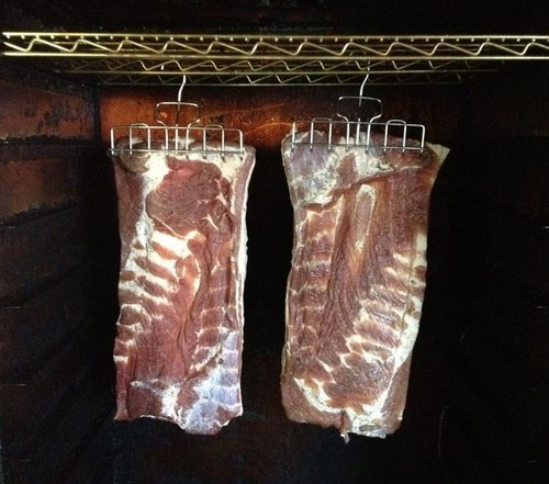 Smoking bacon and hanging it in the smoker