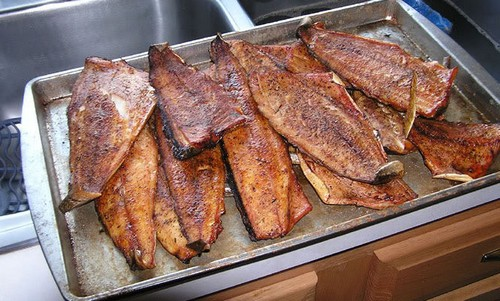Smoking fish on a tray