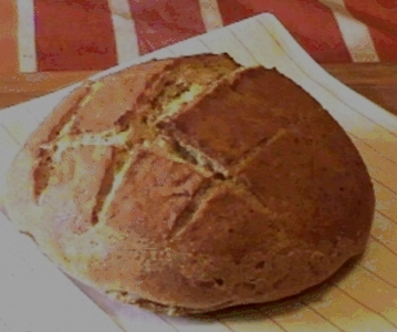 a round loaf of freshly baked sourdough bread