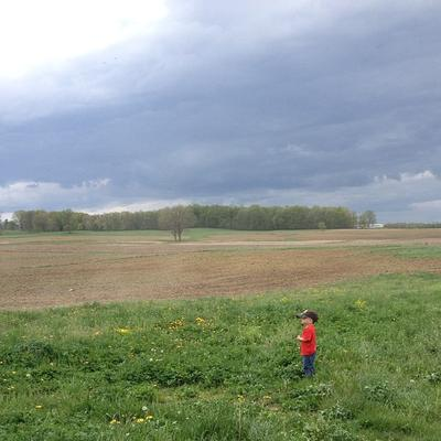 Little man, big world.  Ruger watches Daddy work ground.  Patiently waiting for a tractor ride.