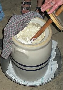 Making homemade butter with a butter churn.