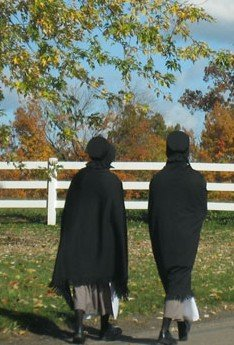 2 Amish girls dressed in their traditional Amish clothes