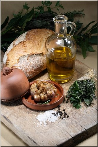 bread, olive oil, shallots and herbs on a wooden cutting board