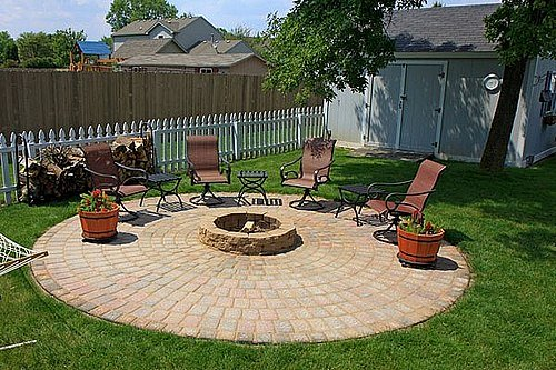 Outdoor patio furniture around the fire pit and patio.
